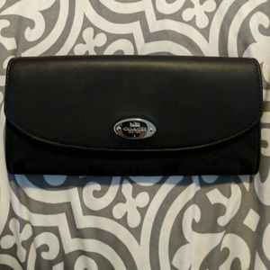 Black coach wallet with snap closure